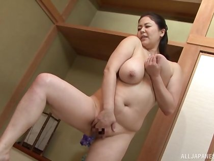 Busty Japanese mom is ready to take on the young dick