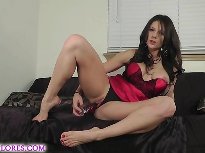 Busty unlit in a satin apparel is posing and toying will not hear of pussy from the back