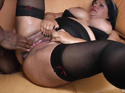 Interracial sex between a black dude and a fat matured babe
