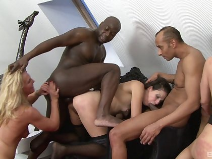 Wild interracial group sex with a dismal dude and naked sluts