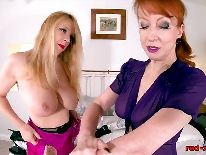 Red XXX and Lucy Gresty share a copy sided dildo