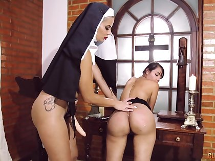 Kinky nun uses a strapon to light of one's life wet pussy of a sinner piece of baggage