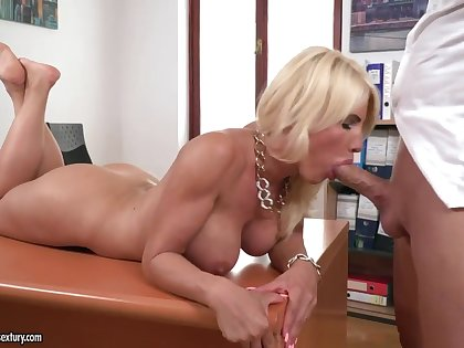 Stacked office adjunct Tiffany Rousso gives her boss a great blowjob